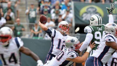 Patriots doblegan a los Jets y Brady establece récord de victorias