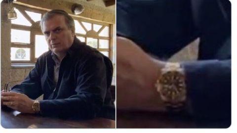 Critican a Marcelo Ebrard por tratar de esconder su Rolex en reunión con AMLO