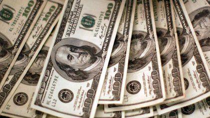 Dólar cae por COVID-19 y elecciones EEUU