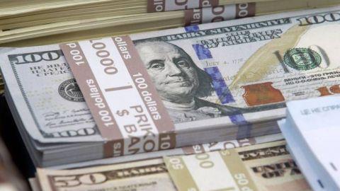 Dólar se desinfla a menos de 21 pesos tras elecciones reñidas de EU