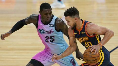 Curry impulsa remontada de Warriors ante Heat en la prórroga