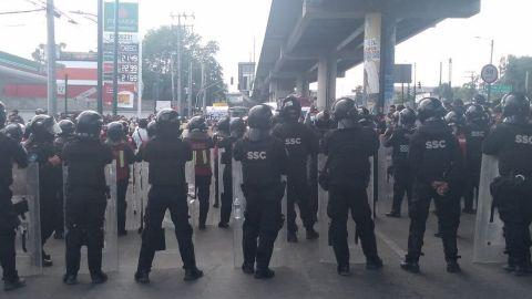 Al grito de 'No fue un accidente, fue el Estado' protestan por desplome en L12