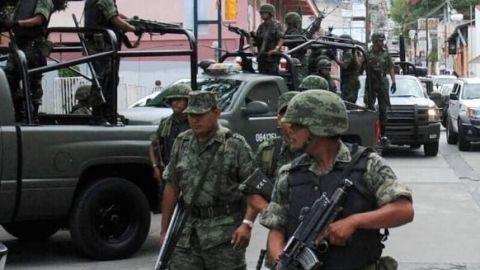 Aseguran arsenal y dinero en Tecate