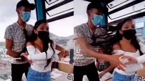 Pareja 'arma bailongo' en góndola de Cablebús de CDMX